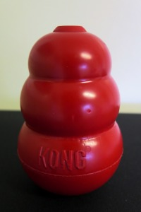 A big red classic KONG dog toy