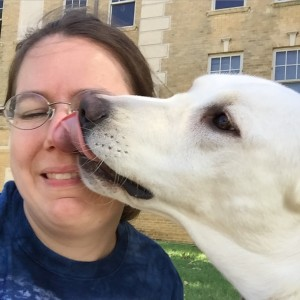 Service dog Logan gives me a kiss