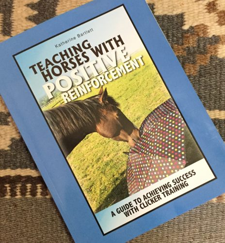 """A picture of the book """"Teaching horses with positive reinforcement"""" by Katherine Bartlett"""